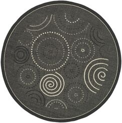 Mullen Black/Sand Circle Outdoor Rug Rug Size: Rectangle 4' x 5'7