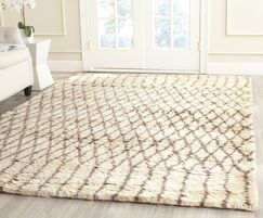 Gholston Tan/Brown New Zealand Area Rug Rug Size: Rectangle 9' x 12'