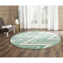 Martins Hand-Tufted Teal/Ivory Area Rug Rug Size: Rectangle 4' x 6'
