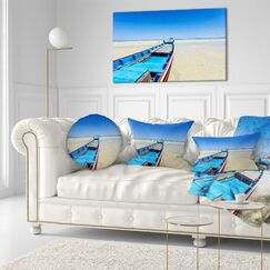 Seashore Long Tail Boat Stand at the Beach Throw Pillow Size: 20