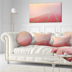Landscape Printed Sunrise over Rows of Tulips Throw Pillow Size: 20