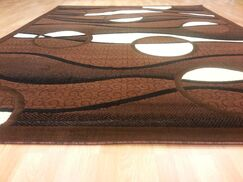 Hand-Carved Brown Area Rug Rug Size: Rectangle 3' x 5'