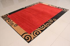 Thamm Orange Area Rug Rug Size: 7'11