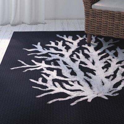 Fairhill Geometric Print Navy Indoor/Outdoor Area Rug | 50 Nautical Inspired Ideas For Home Decor | Inexpensive Nautical Decor | DIY Home Decor | theMRSingLink