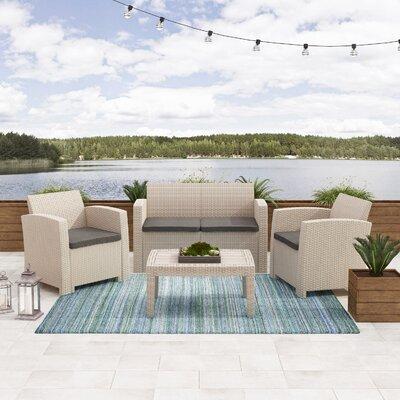 Ebern Designs Faris Rattan Sofa Seating Group Set Cushions